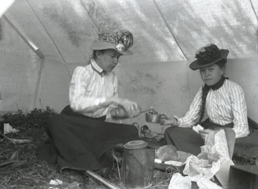 Mary L. Hege and Daisy in tent, Glacier
