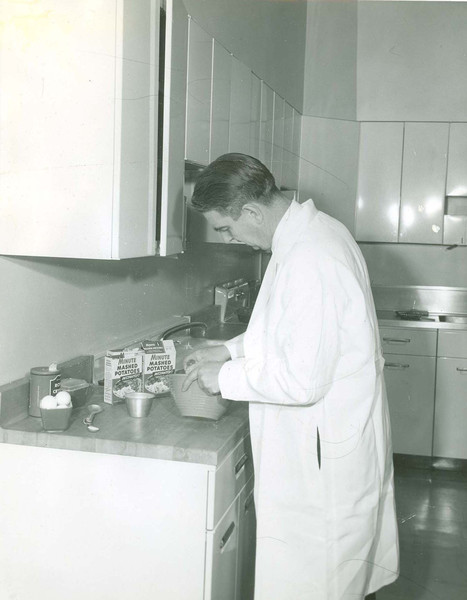 Dr. Lendal Kotschevar making instant mashed potatoes.