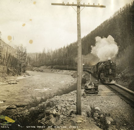 Steam passenger train at Belton, Montana.
