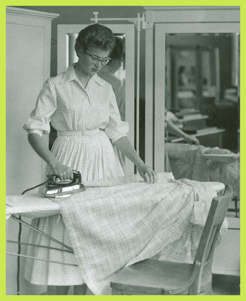 A student ironing.