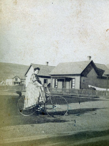 Mrs. Crain on a bicycle, Missoula, Montana.