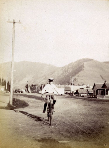 Carl H. on bicycle, Missoula, Montana.
