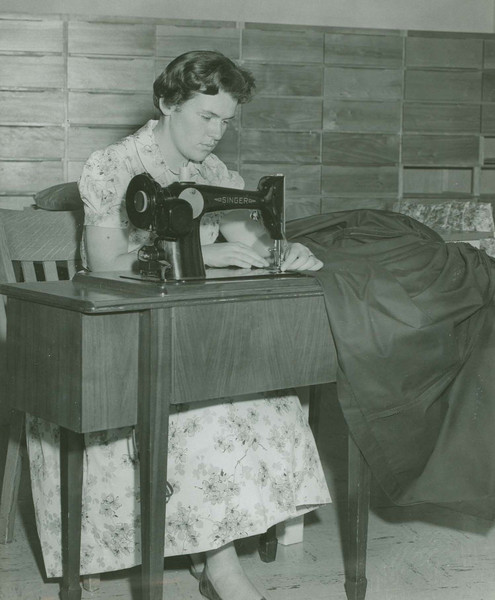 Woman sewing on machine.