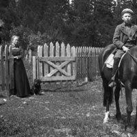 A boy sits on a horse