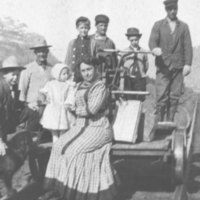 Family posed on railway cart