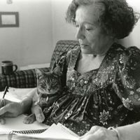 Photograph of Patricia Goedicke writing