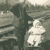 A boy with a baby in carriage