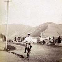 Carl H. on bicycle, Missoula, Montana.