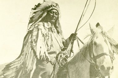 Man in headdress sitting on horse